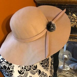 Tan hat with furry accent on the side.